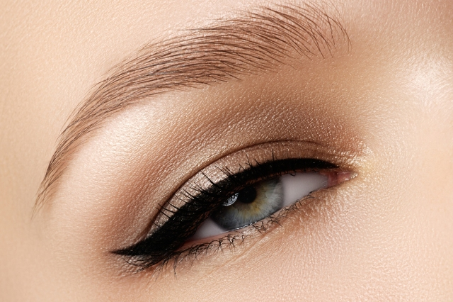 Cosmetics & make-up. Beautiful female eye with sexy black liner