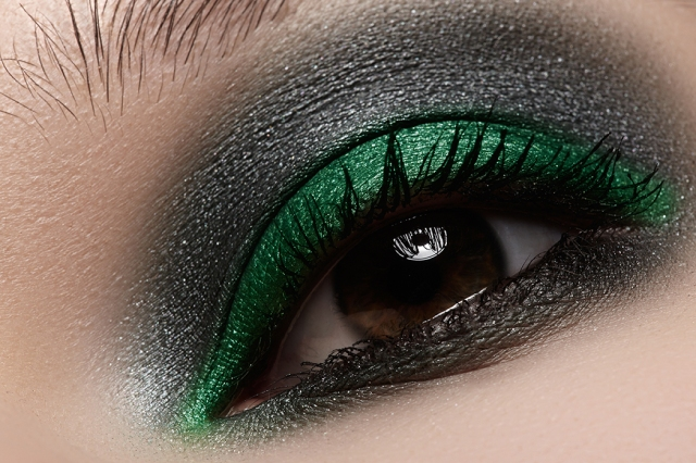 Elegance close-up of female eye with dark gray eyeshadow