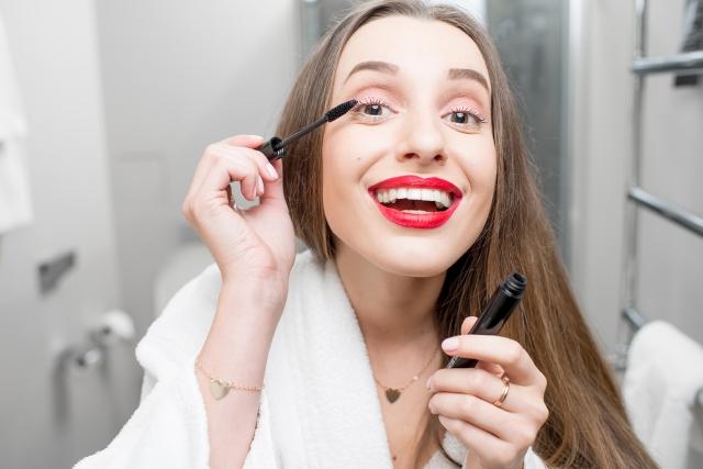 Woman painting eyelashes